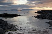 stock photo of eigg  - Sunsetting over the sea at Arisaig Scotland with the islands of Rum and Eigg in the distance at the beach where Local Hero was filmed - JPG