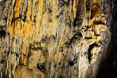 pic of stalagmite  - Limestone wall in cave covered with dripstone - JPG