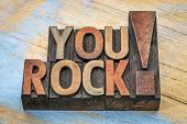 You rock compliment in vintage letterpress wood type printing blocks stained by color inks poster