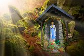 Постер, плакат: Our Lady of Lourdes Virgin Mary on place of wonders wishing well in deep Bohemian forest Konstan