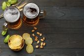 Glass Beer With Hop Cones, Pistachio And Wheat Ears On Dark Wooden Background. Beer Brewery Concept. poster
