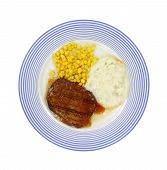 pic of frozen tv dinner  - Salisbury steak meal with corn and potato on a blue striped plate - JPG