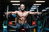 Brutal Strong Bodybuilder Athletic Men Pumping Up Muscles With Dumbbells. poster