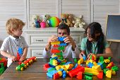 Young Family Spends Time In Playroom. Mom, Dad And Boy poster