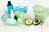 Skincare and body care spa beauty treatment with avocado, bath salts, sponges, face cloths, tea tree poster