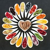 Health food nutrition for a healthy heart with fruit, vegetables, fish, herbs and spices with turme poster