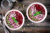 Beet Smoothie Bowl With Chia Seeds, Coconut, Pumpkin Seeds, Quinoa, Sunflower Seeds And Mint poster