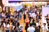 Abstract Blurred Image Of People Walking In Shopping Centre Or Exhibition Hall Event Background. poster