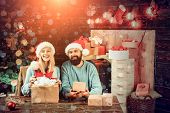 New Year Family With Christmas Present Boxes In Front Of Christmas Tree. Happy Couple Over Christmas poster