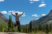 Woman Leaps In Front Of Montana Wilderness In Early Summer poster