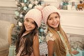 Trendy Girls. Winter Season Accessory. Children Wear Knitted Hats. Girls Long Hair Happy Smiling Fac poster