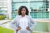 Confident Determined Businesswoman Posing Outside. Young Black Woman Wearing Formal Suit, Standing N poster