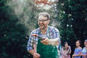 Handsome Male Preparing Barbecue Outdoors For Friends poster