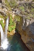 A Beautiful Natural Wild Landscape In The Turkish Mountains With An Interesting Waterfall And The Sa poster