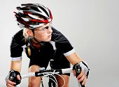 Road bicycle woman riding her bike and concentrating on winning the cycle race. full cycle gear and