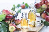 Apple Vinegar. Bottle Of Apple Organic Vinegar Or Cider On Wooden Background. Healthy Organic Food.  poster
