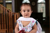 foto of salwar  - cute south asian baby in traditional clothes holding an apple - JPG