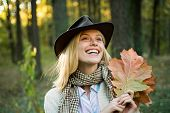 Autumn Outdoor Portrait Of Beautiful Happy Girl Walking In Park Or Forest. Happy Girl On Autumn Walk poster