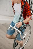 Man Carrying Bicycle Up The Stairs In City. Faceless Photo poster