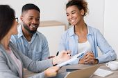 Financial Consultation. Cheerful Black Couple Smiling And Listening To Their Investment Advisor In O poster