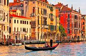 picture of gondolier  - Gondolier navigates the venetian canal - JPG