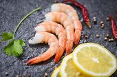 Fresh Shrimps Served On The Dark Plate / Boiled Peeled Shrimp Prawns Cooked With Spices Lemon In The poster