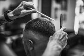 Mens Haircut. Haircut With Scissors. Black And White Photo. poster