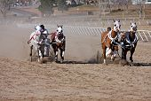 stock photo of chariot  - chariot racing on a sandy race track - JPG