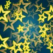 picture of gold glitter  - golden stars over blue background with feather center - JPG