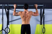 toes to bar man pull-ups 2 bars workout exercise at gym