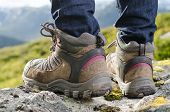 foto of tramp  - two tramping boots before a mountain landscape - JPG