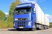 Blue Volvo Fh Truck With Full Trailer