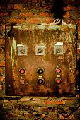 Old Rusty Control Panel On The Brick Wall