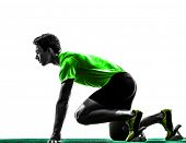 stock photo of sprinter  - one caucasian man young sprinter runner in starting blocks silhouette studio on white background - JPG