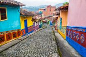 pic of medellin  - Colorful colonial houses on a cobblestone street in Guatape Antioquia in Colombia - JPG