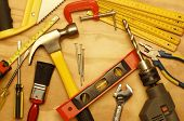 image of hammer drill  - Assorted work tools on wood - JPG