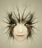 stock photo of gothic female  - Artistic surreal portrait of a beautiful face of a young woman transformed in mysterious creature - JPG
