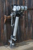 image of outboard  - Old outboard motor placed on a wooden wall - JPG