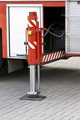 pic of fulcrum  - Pneumatic support foot of red fire truck - JPG