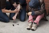 image of heroin  - Three stoned drug addicts shooting heroin outdoors - JPG