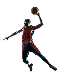 picture of slam  - one african man basketball player jumping dunking in silhouette isolated white background - JPG