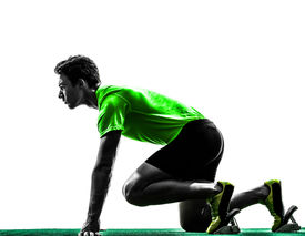 foto of sprinters  - one caucasian man young sprinter runner in starting blocks silhouette studio on white background - JPG