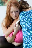 image of underage  - Teenage girl consoling her pregnant best friend - JPG