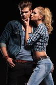 stock photo of hand kiss  - Hot blonde woman trying to kiss her boyfriend on the cheek - JPG