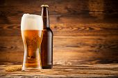 picture of alcoholic beverage  - Glass and bottle of beer with wheat ears on wooden planks - JPG
