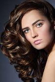 stock photo of perm  - Portrait of young beautiful woman with healthy long curly hair - JPG