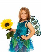 foto of stage decoration  - Beautiful little girl in stage costume holding sunflower and peacock dress - JPG