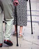 image of old couple  - Elderly couple using walking sticks - JPG