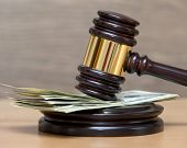 picture of american money  - Law gavel on a stack of American money - JPG
