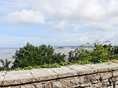 stock photo of mont saint michel  - view of Tombelaine island and tidal bay at low tide from mont saint - JPG